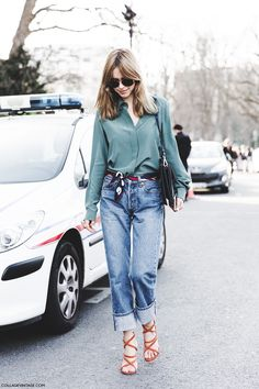 Pernille Teisbaek, a solid go-to for outfit inspiration. We love how she's used her silk scarf as a belt with boyfriend jeans! #lookdepernille #pernilleteisbaek #howtowearasilkscarf