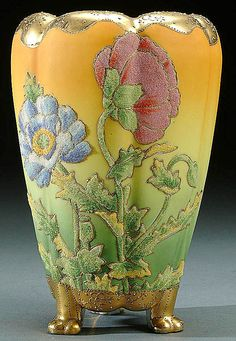 A NIPPON CORALENE DECORATED PORCELAIN FOOTED VASE  CIRCA 1909 WITH BEADED GLASS DECORATION OF CARNATIONS ON A SHADED AMBER TO GEEN GROUND