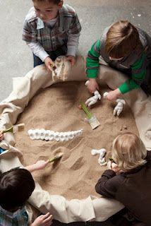 Digging up dinosaur bones.