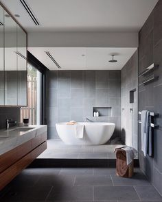 Bathroom Ideas  |  Natural looks create a soothing home  |  Gray large format tile  |  Floor Tile  |  Wall Tile  |  Interior Design  |  Design Milk