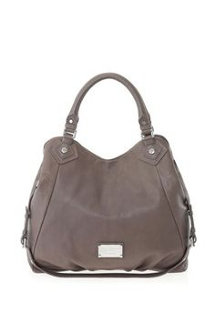 """A key Marc by Marc Jacobs accessory, the Classic Q Francesca is a spacious yet casual everyday bag, and perfect for women on the go. The Francesca features our signature logo plaque detailing, as well as a detachable cross-body strap, providing many convenient carrying options. 100% Cow Leather.20"""" x 4 .5"""