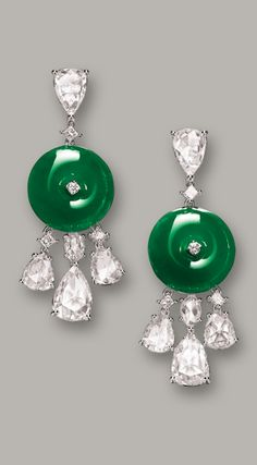 PAIR OF JADEITE 'HUAIGU' AND DIAMOND PENDENT EARRINGS Each suspending a jadeite huaigu of highly translucent emerald green colour, supporting three pear-shaped rose-cut diamonds, and an inverted pear-shaped rose-cut diamond, diamonds altogether weighing approximately 4.00 carat, mounted in 18 karat white gold. Huaigus approximately 14.88 x 14.91 x 4.30mm and 15.00 x 14.86 x 3.60mm.