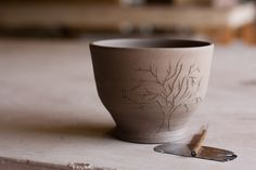 Pottery. Made one last fall w/ an etching.