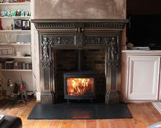 @ConturaStoves Freestanding i5 #woodstove with reclaimed brick slip chamber, slate tiled hearth and cast iron mantel