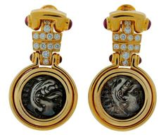 for sale on signature coin earrings created by bulgari in italy in the feature two ancient silver coins set in yellow gold and accented with round