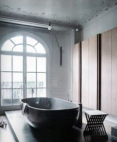 I believe that when your able to mix two or three styles you bring excitement into a room. In this bathroom it's the vintage architecture mixed with contemporary fixtures and traditional tones.