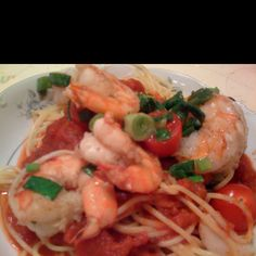 Pasta with lemon garlic shrimp & cherry tomatoes with a little sprinkling of scallions on top ;)