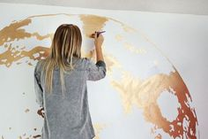 love this idea paint a globe in metallic paint on the wall