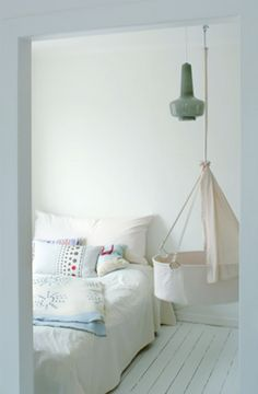 Hanging Baby Cot - what a pretty and clean space