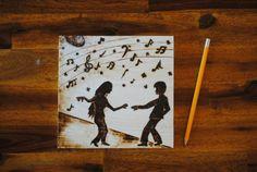 wood burning couple under music dance