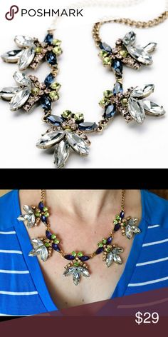 "Firefly Crystal Statement Necklace A delicate flowered design that will easily go from day to night. Pair it with jeans and a tshirt or your little black dress! Chain measures 20"" with a 3"" extender, but can be worn much shorter. Design measures 8""x2"". Bedecked & Bedazzled Jewelry Necklaces"