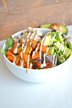 This balance bowl is a perfectly balanced paleo meal that is coated in the tastiest tahini dressing. YUM!