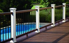 Decking: Transcend  ® in Spiced Rum and Vintage LanternRailing: Transcend in Classic White with Beveled rails in Vintage Lantern and round a...