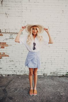 flowy white blouse and light blue wrap skirt