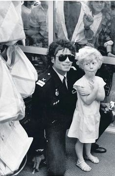 Michael with a little girl