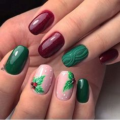 Loving the red and green nail colors, perfect for Christmas. Love the nail art of holly and berries too. #Christmas #nails #nailart #redandgreen #holidays