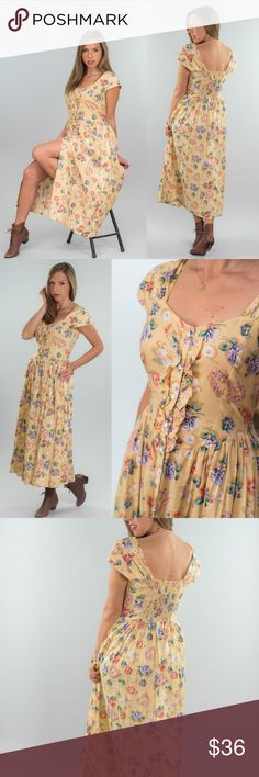 Vintage Yellow Floral Picnic Dress wide gathered shoulder straps  sweet heart neck smocked back button down front cinch waist pockets   c o l o r : banana yellow m a t e r i a l : cotton m a k e r : chandri c o n d i t i o n : excellent     { m e a s u r e m e n t s }  taken with garment laying flat  b u s t : 17 to 18 inches (armpit to armpit) w a i s t : 14 inches across h i p : open l e n g t h : 50 inches (from shoulder) Vintage Dresses Maxi