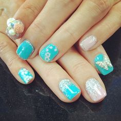 Cyan or teal? Pick your favourite colour scheme and jewels.  #aritumspa #nails #nailart #manicure