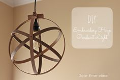 Embroidery Hoop Light Pendant DIY. This looks so high end, but is so simple to make!  Winning tutorial from Creating with the Stars Link Up Week 1.