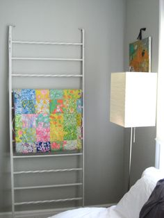 old railing used as quilt display! clever!