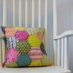 We love the bright colored Hexagon pillow! Too cute.  Hexies  #hexie #hexi #hexagons Hexagon Precuts