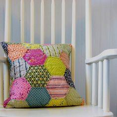 We love the bright colored Hexagon pillow! Too cute.  Hexies  #hexie #hexi #hexagons Hexagon Precuts