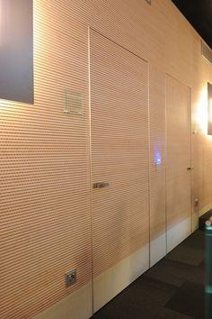 Consorzio dei Comuni_Trento.  Topakustik wall cladding, wall flush doors.