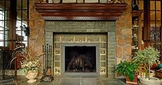 The Arts & Crafts movement was famous for beautiful handmade tiles, like these fireplace tiles from standout-fireplace-designs.com