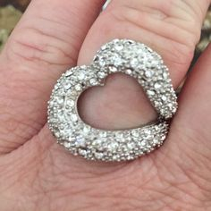 New Years Delight!  Crystal Love Ring - size 9 Crystal Love Ring - size 9. Sideways heart ring. Excellent used condition. Jewelry Rings