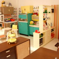 Mini Kitchen! Look at the lil appliances on the top of the cupboards!