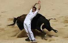 A recortador bends backwards to allow a rampaging bull to pass him during a contest at the Pamplona bullring on the third day of the San Fermin festival in Pamplona, Spain, on July Ibiza, Disney Magic Kingdom, Best Places To Live, Pictures Of The Week, Travel Images, Summer Travel, National Geographic, In This Moment, My Love