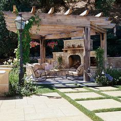Patio Pergola This outdoor room even has a fireplace for friends and family to gather around when the nights get cool.