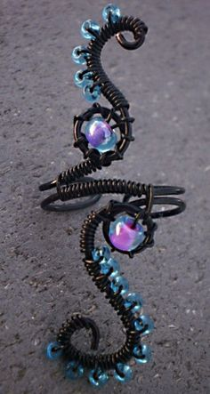 Ocean vines ear cuff NO piercing required FREE Shipping in Origami gift box. $11.99, via Etsy.