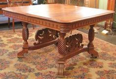 Antique dining table, Victorian carved walnut with rope twist and leaf details.