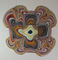Layers of acrylic paint poured over plywood by Holton Rower