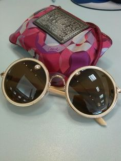 Poppy Coach and round sunglasses