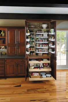 OMG I NEED THIS!!!!  Super Chef Pantry  Five adjustable turntables, four adjustable door mount shelves and three adjustable roll out trays in lower portion.