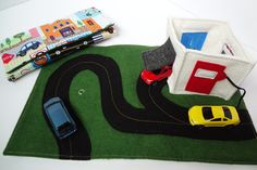 love the pop-up carwash/fast food/gas station  Cars Travel Play Mat for On-The-Go...CAR INCLUDED. $35.00, via Etsy.