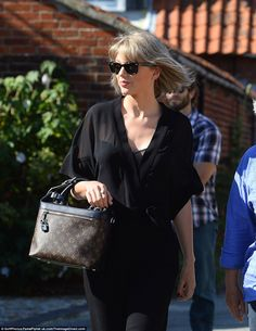 aa98da716fd Big day  Taylor was dressed to impress in a stylish black jumpsuit over a  dark