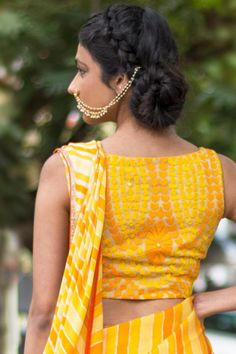 Ready to shop blouses | House Of Blouse Yellow orange threadwork blouse - An airy sleeveless in a classic boat neck style. This head turner in cheery yellow and orange threadwork, is truly chic in it's simplicity. For enquiries Whatsapp +91 81050 68601. *Shipping worldwide* #saree #blouse #sareeblouse #blousedesigns #desi #indianfashion #india #bollywood #threadwork #yellow