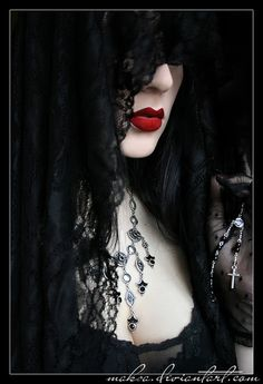 .love the red lips with the black hair