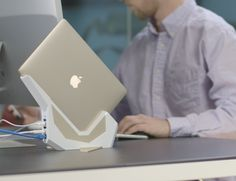 "With Sparrow, all you do is slide in your cool, new 12"" MacBook into our badass, new dock."