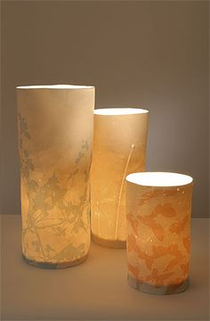 Liz Emtage Ceramics    Porcelain lamps are made by mixing paper and porcelain clay. In the firing process the paper burns out leaving a delicate, translucent structure; which suffuses any room with a warm glow.
