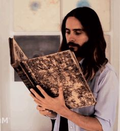 fuckyeahletogifs:  A rare footage of Jesus reading a bible.