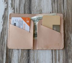 This Wallet is made from vegetable tanned leather and handstitched up by wax thread. love the size and vertical pockets.