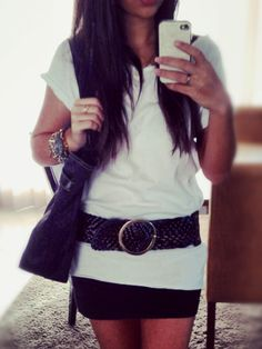 White loose tshirt, black skirt with thick belt