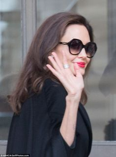 Stealing the show:The actress, 42, cut an incredibly glamorous figure in a chic black cape coat and oversized sunglasses as she spent a day at Le Louvre with her full brood