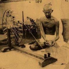 Mahatma Gandhi spinning cotton
