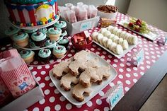 Love everything about this table. Especially the smaller cake with all the cupcakes around it.