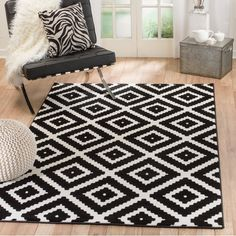 Balancing bold patterns with a stark, monotone palette, this eye-catching area rug brings a bit of striking sophistication to your look. Featuring a bold geometric motif in black and white tones, this loomed rug draws the eye in your aesthetic, while its wool and olefin design makes it a stain- and fade-resistant addition to your space. Set it on a light wood floor in the living room to let its black diamonds pop, or let it sit underneath a glass-top table in the dining room to let its…